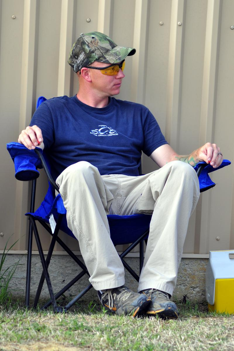 Man Sitting in Camping Chair